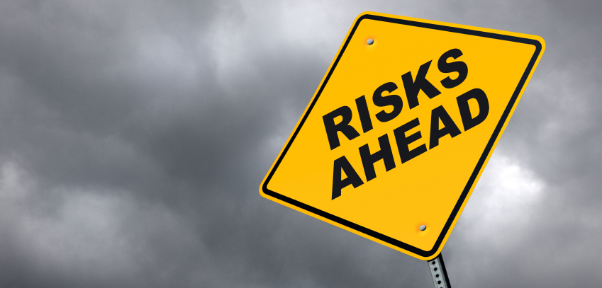 Image: Sign saying 'Risks Ahead!'