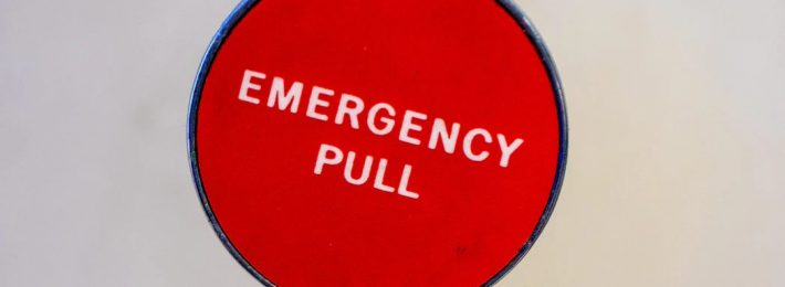 """Campus in Crisis: Image of red """"Emergency Pull"""" button"""
