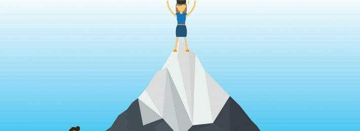 Student climbing a mountaintop