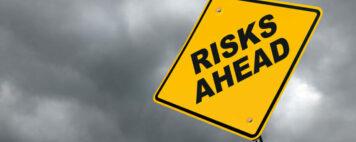 """Risks Ahead"" Caution Roadsign"