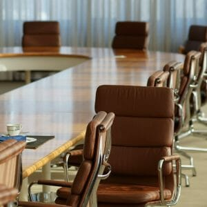 Picture of a boardroom table at a college campus