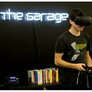 Makerspaces and Academic Incubators: A student using a virtual reality headset at the Garage
