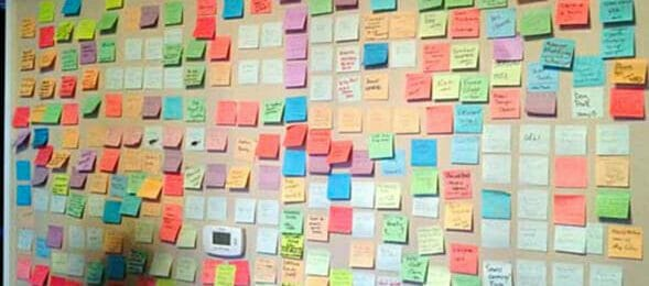 Colored post-it notes stuck on a wall during a brainstorm session