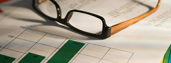 Photo of eyeglasses on top of a report