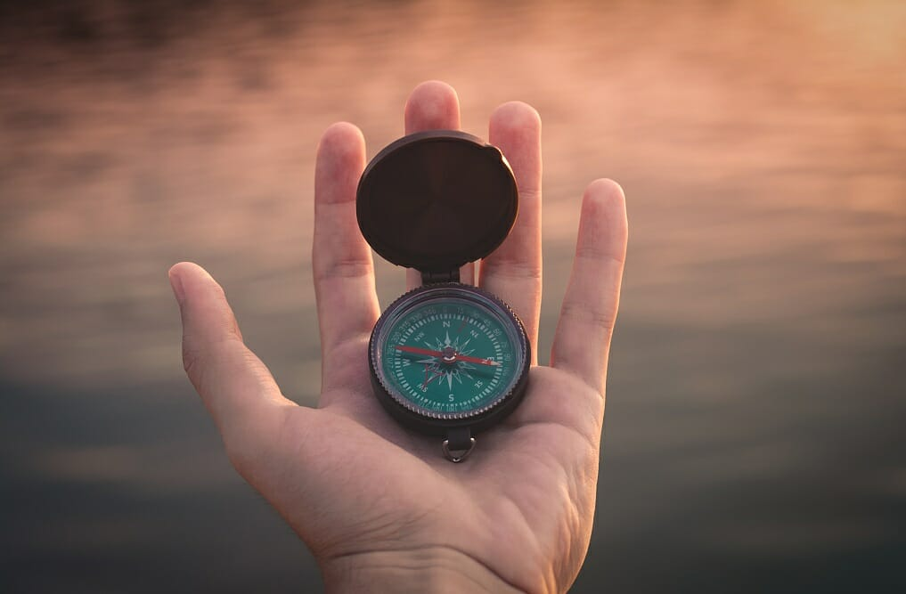 Habits of Highly Effective Higher Ed Professionals - Image of Hand Holding Compass