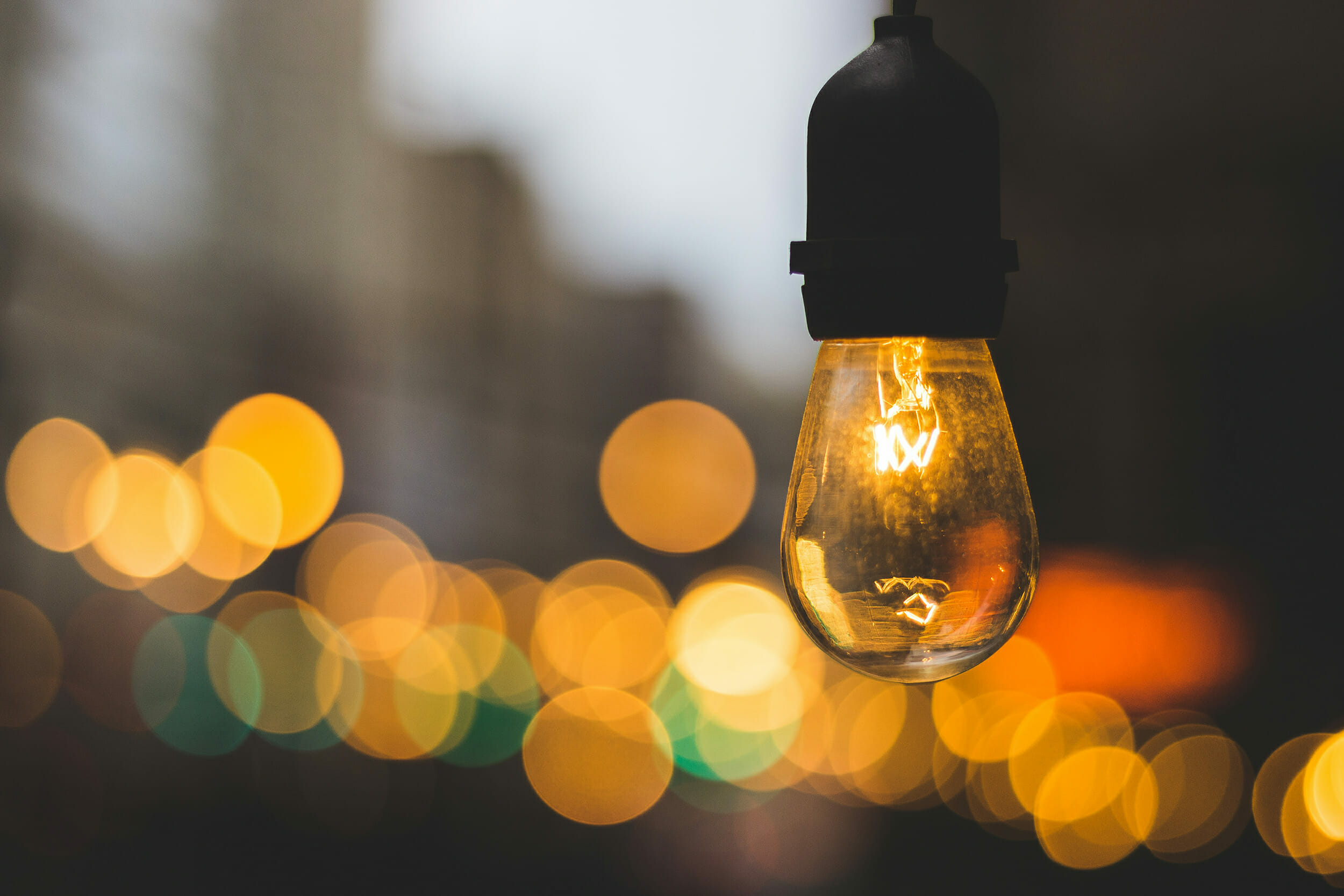 Volunteer management inspiration: Image of a light bulb on a street with a warm glow.