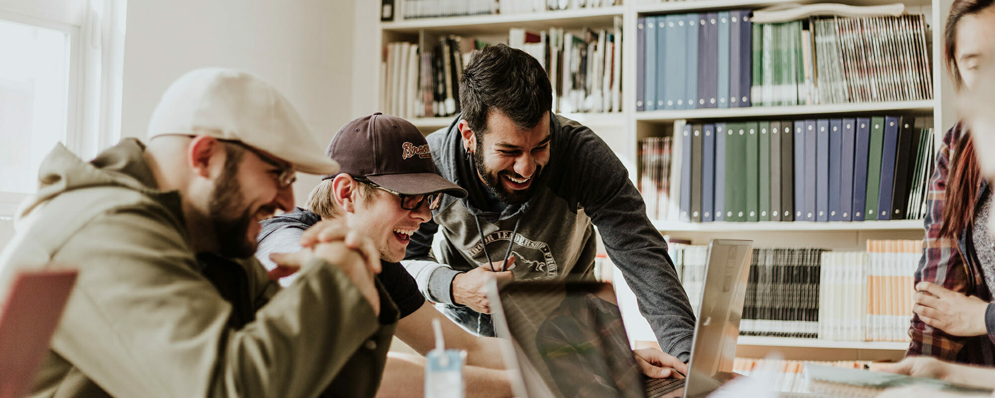 students laughing while using computers