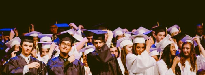 Students at a commencement ceremony