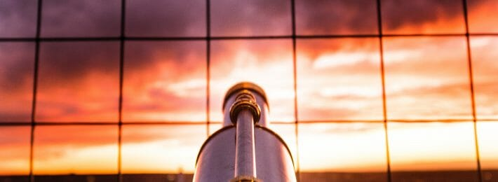 Looking Beyond Our Borders, Hiring Staff From Outside Higher Ed: Image shows a telescope pointed at the horizon