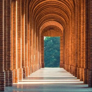 long arched hallway on a campus