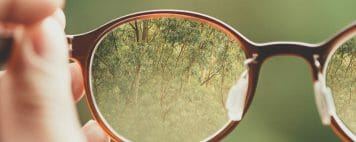 Challenging Andocentrism - Recognizing Women's Vision - Photo of Forest Seen Through Glasses