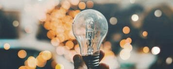 Innovation Center: Image of reflections on a light bulb
