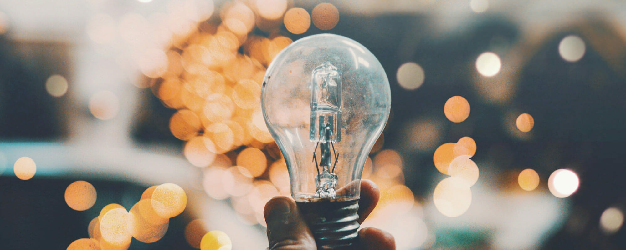 Innovation Center: Image of reflections on a light bulb