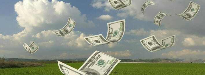 Funding for Innovation: Image of Dollar Bills Falling through the Air