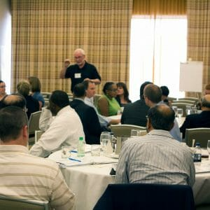 Leading High Performing Teams - Image Shows Pat Sanaghan Facilitating a Workshop about High Performing Teams