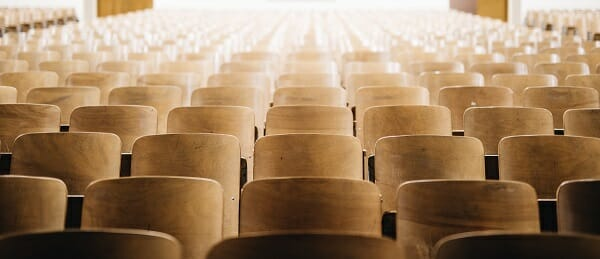 When the University President Exits Abruptly - Image of Empty Lecture Hall Chairs
