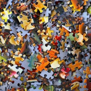 a pile of small puzzle pieces fills the entire frame of the photo