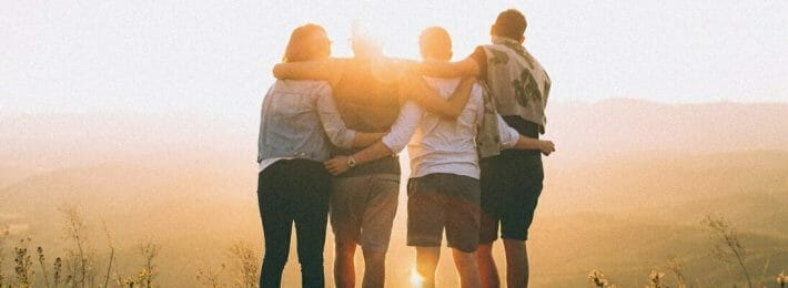 Student Leadership Development - Image of Four Students Facing a Sunset Together