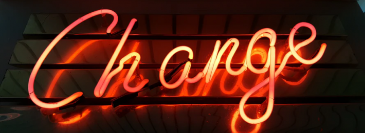 Neon sign spelling the word Change