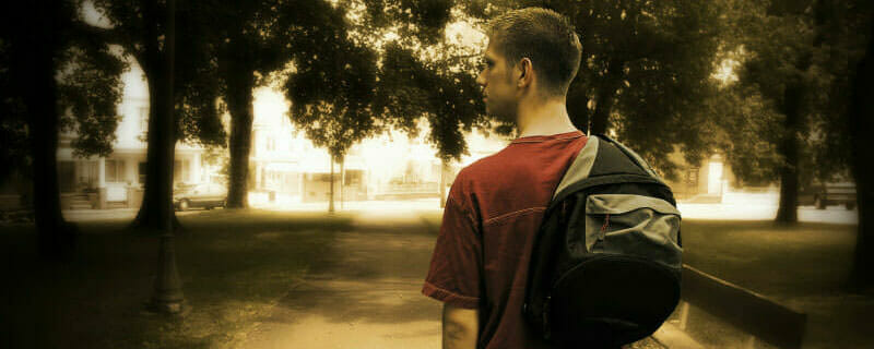 Student walking with a backpack