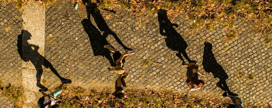 Students walking with long shadows