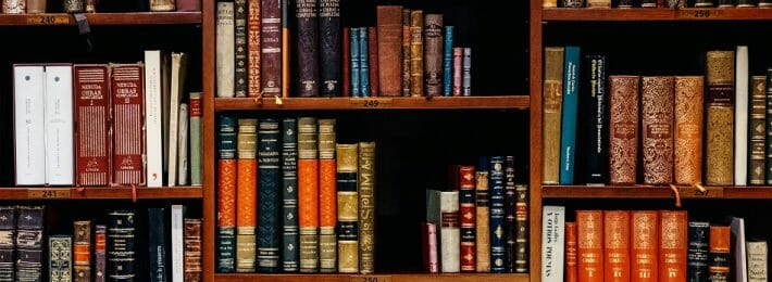 Photo of a bookshelf at an academic library