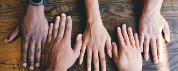 Photo of hands with diverse skin tones