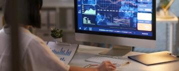 Woman analyzing data on a computer