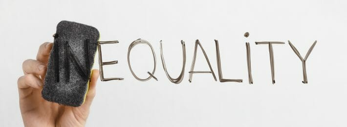 Equality written on a dry erase board