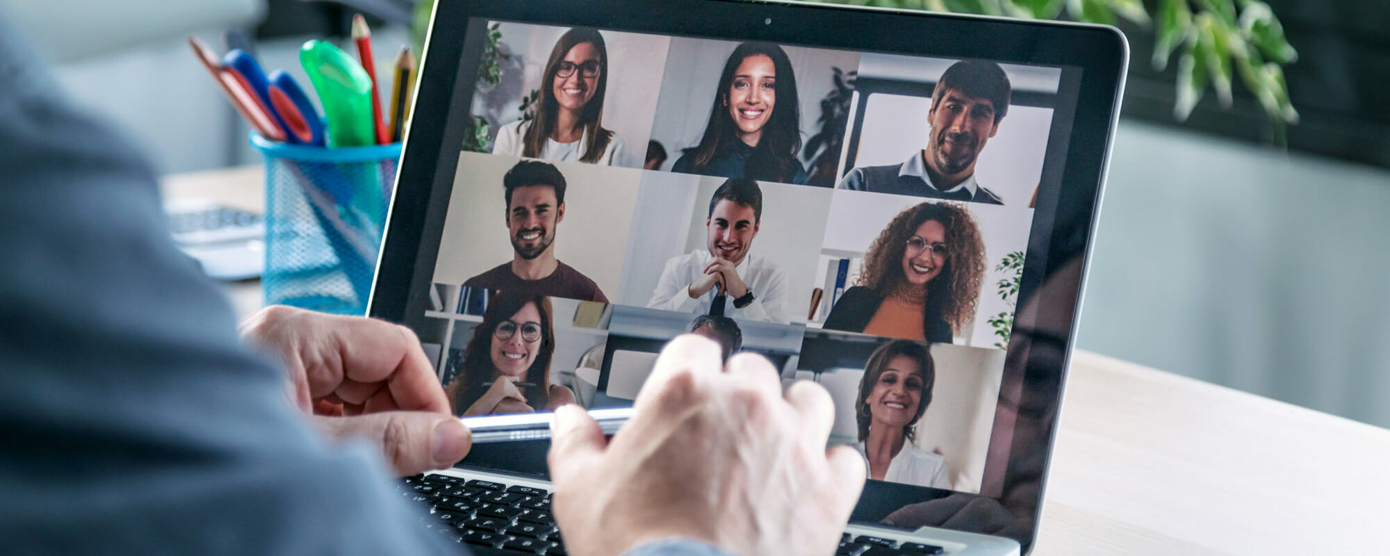 Video call with other professionals on a laptop