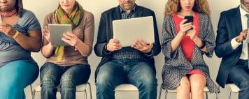 Diverse people on digital devices