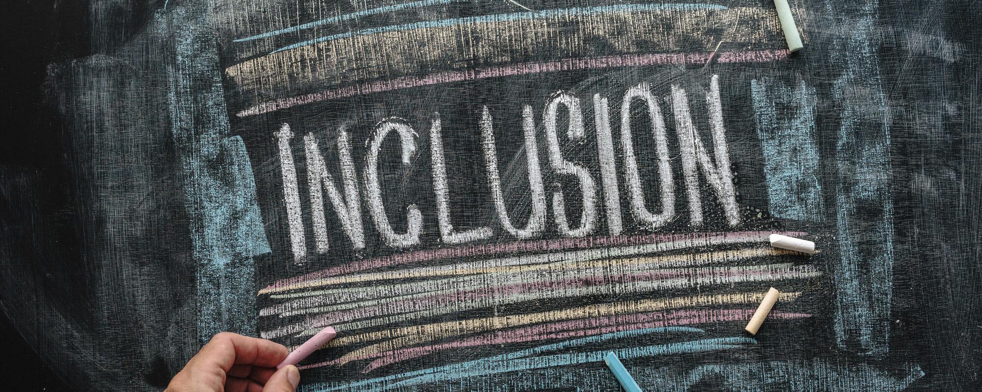 Inclusion written on chalkboard