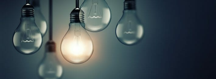 Hanging lightbulbs with one lit