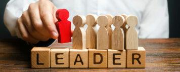 Leader spelled out on wooden blocks