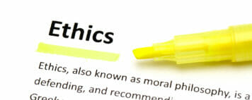 Definition of ethics highlighted in a dictionary